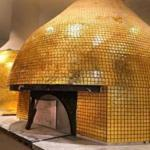 Gold tiled Italian pizza ovens at the new Eataly.